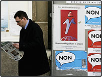 A man walks past campaign posters
