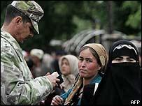 Women at a checkpoint in Korasuv, Uzbekistan, 19 May 2005