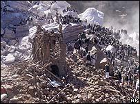 Villagers gather to survey the destruction in al-Dhafir, Yemen