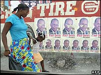 Posters of a candidate in next month's presidential election in Haiti