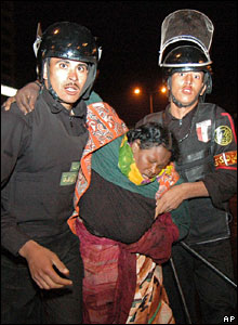 A woman is carried away by Egyptian security forces