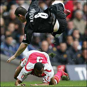 Ashley Cole fouls Wayne Rooney