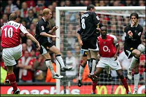 Dennis Bergkamp shoots from a free-kick