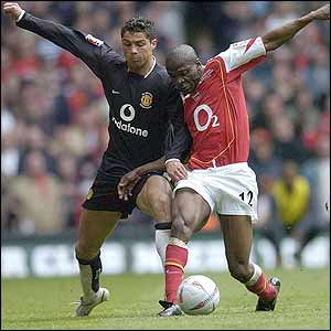 Christiano Ronaldo takes on Arsenal's Lauren
