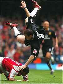 Wayne Rooney takes a spectacular tumble