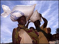 Women in Livingstone, Zambia, collect UN food aid