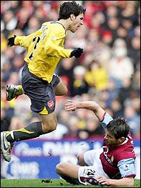 Arsenal's Cesc Fabregas avoids Eirik Bakke's challenge