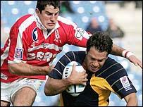 Thomas Lombard is tackled by Stephane St Lary