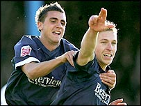Freddy Eastwood (right) celebrates his match-winning penalty