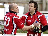 Gregor Townsend (left) and Simon Danielli celebrate the Borders' opening try