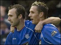 Thomas Buffel and Peter Lovenkrands celebrate against United