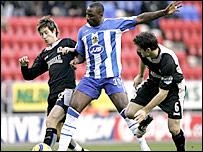 Wigan's Jason Roberts battles for possession