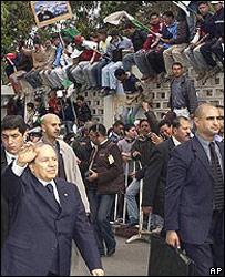 President Abdelaziz Bouteflika, left, walks through Algiers