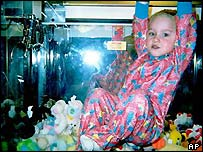 James Manges inside the toy machine