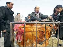 Vendors at a market in western China. Archive picture