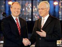 Peer Steinbrueck (SPD) (left) and Juergen Ruettgers (CDU)