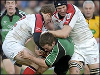 John Fogarty of Connacht is tackled by Ulster's Andrew Trimble and Justin Harrison
