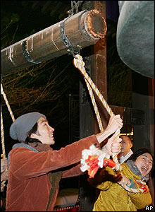 Worshippers strike a bell to celebrate New Year at Zojoji Buddhist temple in Tokyo