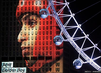 Image of boxer Amir Khan on building as backdrop