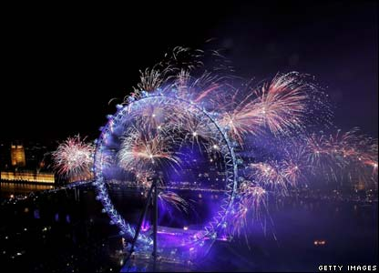 Fireworks light up the London Eye and Houses of Parliament (left)