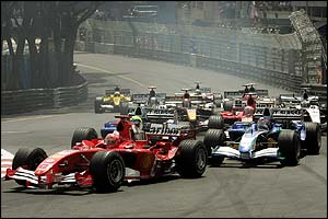 Michael Schumacher leads a pack of cars before running into trouble on lap 24