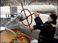 Russian NTV grab shows Russian employee turning gas valve in Kursk region