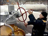 Russian NTV grab shows Russian employee turning gas valve in Kursk region