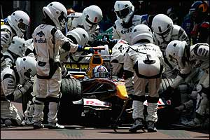 A Red Bull pit crew dressed as Star Wars extras attend to David Coulthard's car