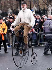 Man on penny farthing bicycle