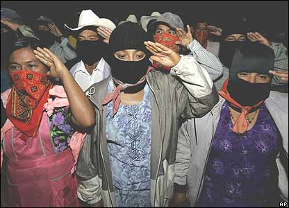 Women Zapatistas salute in La Garrucha