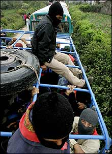 Zapatistas on board bus in La Garrucha before leaving on tour
