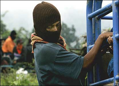 Zapatista clings to vehicle