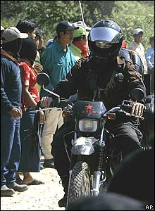 Marcos rides through La Garrucha Zapatista village in southern Mexico