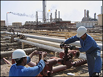 Workers at an Iraqi oil facility