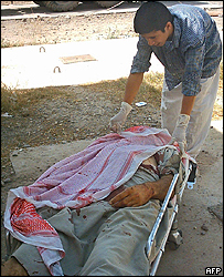 Medic covers body of a bomb victim in Samarra