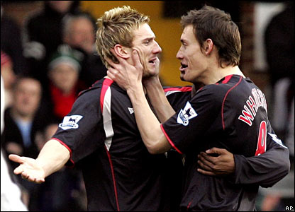 Liam Lawrence (L) is mobbed by his Sunderland team-mates