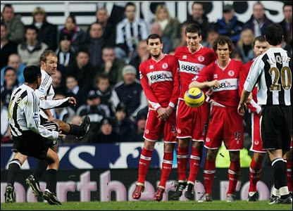 Nolberto Solano scores from a free-kick for Newcastle