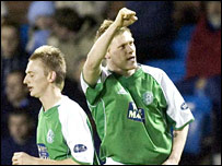 Garry O'Connor salutes the Hibs fans after his goal