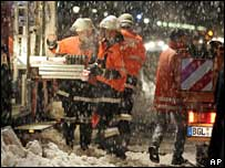 Rescue workers in the snow