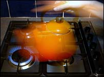 A kettle on a gas stove