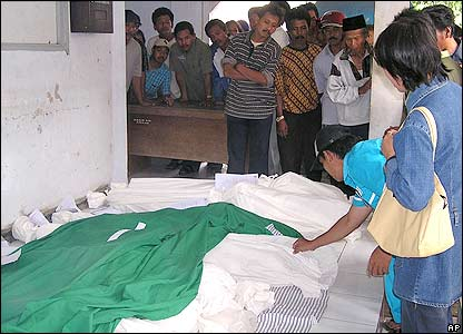 Relatives try to identify the bodies of flash flood victims at a hospital in Jember, East Java, Indonesia, Monday, Jan. 2, 2006.