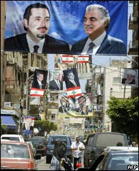 Posters in Beirut show ex-Lebanon PM Rafik Hariri, and his son Saad