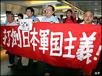 "Chinese protesters in Hong Kong hold a banner reading ""Overthrow Japan's militarism""  - archive picture"
