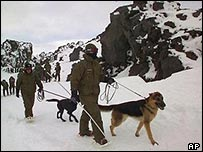 Chilean soldiers search for colleagues lost in a blizzard