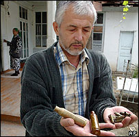 Saidjahan Zainabiddinov shows cartridge case outside his apartment in Andijan, Uzbekistan May 16, 2005