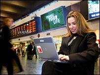 Woman using laptop in a station