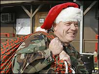 US soldier dressed as Father Christmas