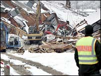 Rescue workers sift through debris at a collapsed ice rink in Bad Reichenhall, Germany