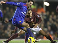 Manchester United's Ruud van Nistelrooy and Arsenal's Gilberto