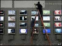Wall of screens at CES, AP